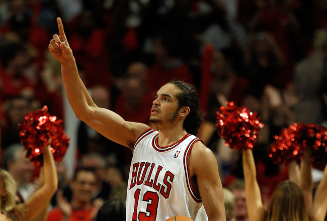 CHICAGO - APRIL 22: Joakim Noah #13 of the Chicago Bulls celebrates a win over the Cleveland Cavaliers in Game Three of the Eastern Conference Quarterfinals during the 2010 NBA Playoffs at the United Center on April 22, 2010 in Chicago, Illinois. The Bull
