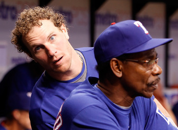 ST. PETERSBURG - AUGUST 17:  Outfielder Josh Hamilton #32 of the Texas Rangers clowns around behing manager Ron Washington #38 during the game against the Tampa Bay Rays at Tropicana Field on August 17, 2010 in St. Petersburg, Florida.  (Photo by J. Meric