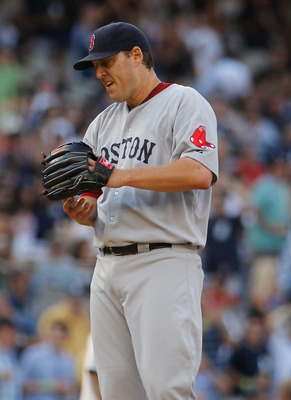 NEW YORK - AUGUST 07:  John Lackey #40 of the Boston Red Sox reacts against the New York Yankees on August 7, 2010 at Yankee Stadium in the Bronx borough of New York City.  (Photo by Mike Stobe/Getty Images)