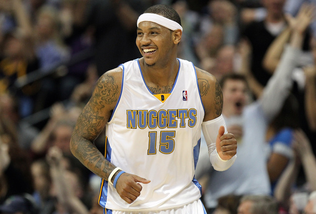 DENVER, CO - APRIL 17 : Carmelo Anthony #15 of the Denver Nuggets celebrates after sinking a shot against the Utah Jazz during the second half of Game One of the Western Conference Quarterfinals of the 2010 NBA Playoffs at the Pepsi Center on April 17, 20