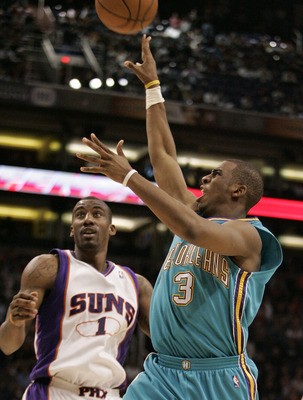 PHOENIX - FEBRUARY 06:  Chris Paul #3 of the New Orleans Hornets shoots over Amare Stoudemire #1 of the Phoenix Suns on February 6, 2008 at US Airways Center in Phoenix, Arizona. NOTE TO USER: User expressly acknowledges and agrees that, by downloading an