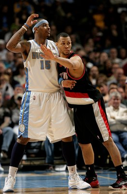DENVER - MARCH 05:  Carmelo Anthony #15 of the Denver Nuggets looks for the ball as Brandon Roy #7 of the Portland Trail Blazers defends during NBA action at the Pepsi Center on March 5, 2009 in Denver, Colorado. The Nuggets defeated the Trail Blazers 106