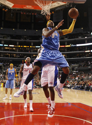 LOS ANGELES, CA - NOVEMBER 26:  Carmelo Anthony #15 of the Denver Nuggets drives to the basket for a layup against the Los Angeles Clippers during the second half at Staples Center on November 26, 2008 in Los Angeles, California. The Nuggets defeated the
