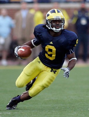 ANN ARBOR, MI - SEPTEMBER 12:  Martavious Odoms #9 of Michigan runs with the ball against Notre Dame at Michigan Stadium on September 12, 2009 in Ann Arbor, Michigan.  (Photo by Domenic Centofanti/Getty Images)