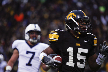 IOWA CITY, IA - NOVEMBER 8: Wide receiver Derrell Johnson-Koulianos #15 of the Iowa Hawkeyes scores a touchdown in the third quarter of play as Anthony Scirrotto #7 of the Penn State Nittany Lions defends on the play at Kinnick Stadium on November 8, 2008