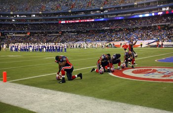 TORONTO - DECEMBER 3:  Members of the Buffalo Bills kneel in the end zone during a break in their NFL game against the New York Jets on December 3, 2009  at Rogers Centre in Toronto, Ontario, Canada. The Jets defeated the Bills 19-13. (Photo by Rick Stewa