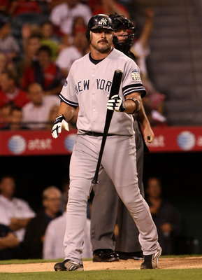 ANAHEIM, CA - SEPTEMBER 08: Jason Giambi #25 of the New York Yankees walks away from home plate after being called out on strikes in the first inning against the Los Angeles Angels of Anaheim on September 8, 2008 at Angel Stadium in Anaheim, California.