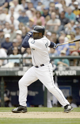SEATTLE - JUNE 18:  Carl Everett #8 of the Seattle Mariners bats against the San Francisco Giants on June 18, 2006 at Safeco Field in Seattle, Washington. The Mariners defeated the Giants 5-1.  (Photo by Otto Greule Jr/Getty Images)