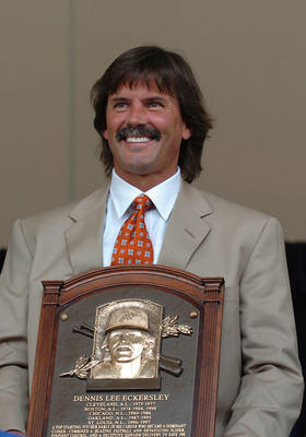Dennis Eckersley poses with his Hall of Fame plaque.