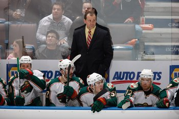 EDMONTON, CANADA - MARCH 5: Head Coach Todd Richards with James Sheppard #51 and Chuck Kobasew #12 of the Minnesota Wild watch the action against the Edmonton Oilers on March 5, 2010 at Rexall Place in Edmonton, Alberta, Canada. (Photo by Dale MacMillan/G