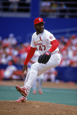 ST. LOUIS - AUGUST:  Lee Smith #47 of the St. Louis Cardinals pitches during a game in August 1992 at Busch Stadium in St. Louis, Missouri.  (Photo by Jonathan Daniel/Getty Images)