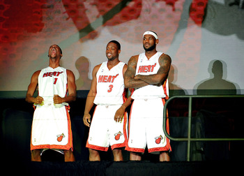 MIAMI - JULY 09:  Chris Bosh #1, Dwyane Wade #3, and LeBron James #6 of the Miami Heat are introduced to fans during a welcome party at American Airlines Arena on July 9, 2010 in Miami, Florida.  (Photo by Doug Benc/Getty Images)