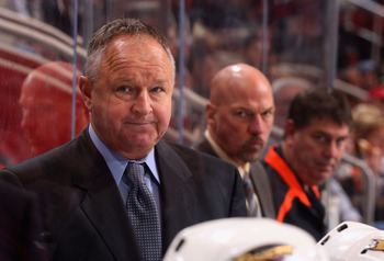 GLENDALE, AZ - DECEMBER 23:  Head coach Randy Carlyle of the Anaheim Ducks looks on from the bench during the NHL game against the Phoenix Coyotes at Jobing.com Arena on December 23, 2009 in Glendale, Arizona. The Coyotes defeated the Ducks 4-0. (Photo by