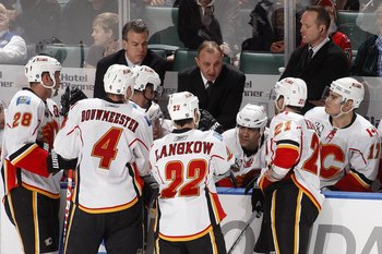 SUNRISE, FL - FEBRUARY 5: Head coach Brent Sutter of the Calgary Flames talks to team members during a time out in the third period of the game against the Florida Panthers on February 5, 2010 at the BankAtlantic Center in Sunrise, Florida. The Flames def