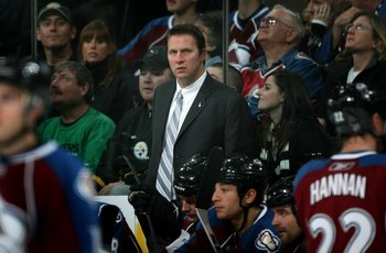 DENVER - NOVEMBER 08:  Head coach Joe Sacco of the Colorado Avalanche leads his team against the Edmonton Oilers during NHL action at the Pepsi Center on November 8, 2009 in Denver, Colorado. The Oilers defeated the Avalanche 5-3.  (Photo by Doug Pensinge