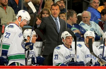 DENVER - OCTOBER 03:  Head coach Alain Vigneault of the Vancouver Canucks leads his team against  the Colorado Avalanche during NHL action at the Pepsi Center on October 3, 2009 in Denver, Colorado.  (Photo by Doug Pensinger/Getty Images)