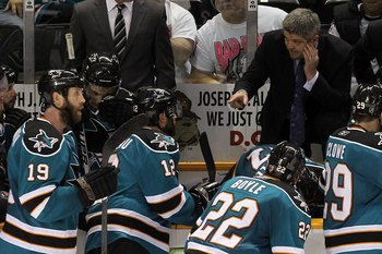 SAN JOSE, CA - MAY 18:  (R) Head coach Todd McLellan of the San Jose Sharks talks with his team while taking on the Chicago Blackhawks in Game Two of the Western Conference Finals during the 2010 NHL Stanley Cup Playoffs at HP Pavilion on May 18, 2010 in