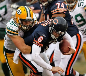 CHICAGO - DECEMBER 13: Clay Matthews #52 of the Green Bay Packers sacks Jay Cutler #6 of the Chicago Bears at Soldier Field on December 13, 2009 in Chicago, Illinois. The Packers defeated the Bears 21-14. (Photo by Jonathan Daniel/Getty Images)
