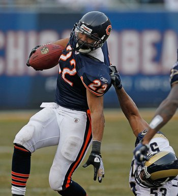 CHICAGO - DECEMBER 06: Matt Forte #22 of the Chicago Bears is brought down by an illegal 'horse-collar' tackle by Paris Lenon #53 of the St. Louis Rams at Soldier Field on December 6, 2009 in Chicago, Illinois. The Bears defeated the Rams 17-9.  (Photo by