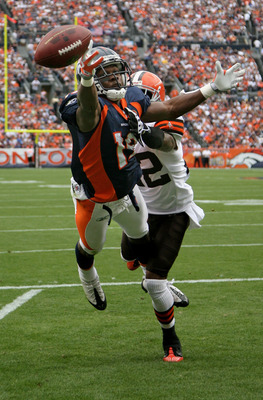 DENVER - SEPTEMBER 20:  Wide reciever Eddie Royal #19 of the Denver Broncos is unable to make a reception in the endzone as defensive back Brandon McDonald #22 of the Cleveland Browns during NFL action at Invesco Field at Mile High on September 20, 2009 i