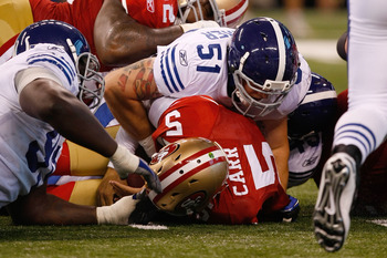 INDIANAPOLIS, IN - AUGUST 15: David Carr #5 of the San Francisco 49ers is sacked by Pat Angerer #51 the Indianapolis Colts during the preseason game at Lucas Oil Stadium on August 15, 2010 in Indianapolis, Indiana.  (Photo by Scott Boehm/Getty Images)
