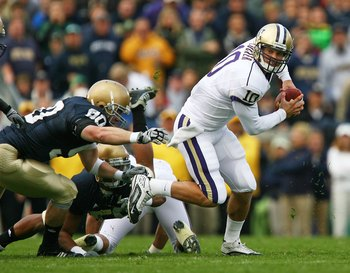 SOUTH BEND, IN - OCTOBER 03: Jake Locker #10 of the Washington Huskies runs away from John Ryan #90 of the Notre Dame Fighting Irish on October 3, 2009 at Notre Dame Stadium in South Bend, Indiana. Notre Dame defeated Washington 37-30. (Photo by Jonathan