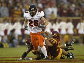 LOS ANGELES - DECEMBER 6:  Wide receiver Mike Hass #28 of the Oregon State Beavers runs after a catch during the game against the USC Trojans on December 6, 2003 at the Los Angeles Coliseum in Los Angeles, California.  USC won 52-28 to become the No. 1 te