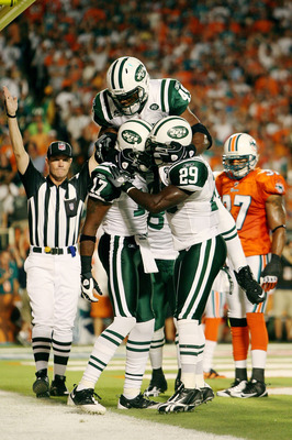 MIAMI - OCTOBER 12:  Wide receiver Braylon Edwards #17 of the New York Jets is congratulated by teammates Tony Richardson #49 and Leon Washington #29 after scoring a touchdown in the first quarter against the Miami Dolphins at Land Shark Stadium on Octobe