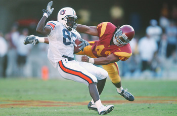 LOS ANGELES - SEPTEMBER 2:  Wide Receiver Silas Daniels #85 of the Auburn Tigers is tackled from behind by strong safety Troy Polamalu #43 of USC during the second quarter at The Los Angeles Coliseum on September 2, 2002 in Los Angeles, California.  USC d