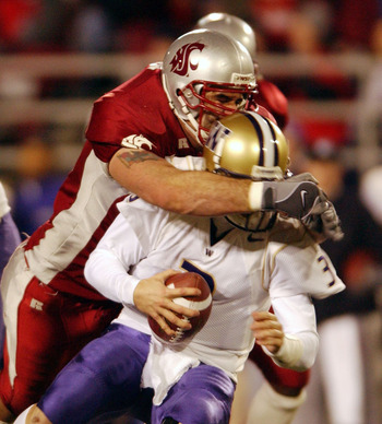 PULLMAN, WA - NOVEMBER 23:  Quarterback Cody Pickett #3 of the Washington Huskies is sacked by Rien Long #88 of the Washington State Cougars on November 23, 2002 at Martin Stadium in Pullman Washington. (Photo by Otto Greule Jr/Getty Images)