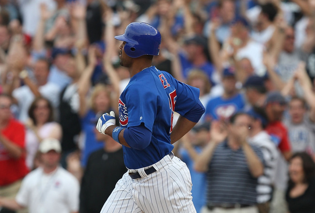 CHICAGO - JUNE 18: Derrek Lee #25 of the Chicago Cubs runs the bases after hitting a three-run home run in the 8th inning against the Chicago White Sox on June 18, 2009 at Wrigley Field in Chicago, Illinois. The Cubs defeated the White Sox 6-5. (Photo by