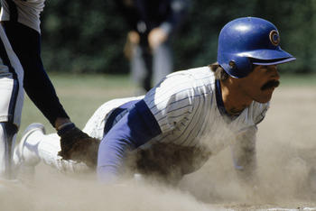 CHICAGO -1980:  Bill Buckner #22 of the Chicago Cubs slides across a base during a game in the 1980 season at Wrigley Field in Chicago, Illinois .  (Photo by: Jonathan Daniel/Getty Images)