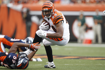CINCINNATI, OH - AUGUST 15: Jermaine Gresham #84 of the Cincinnati Bengals gets tackled after catching a pass by Wesley Woodyard #59 of the Denver Broncos during a preseason game at Paul Brown Stadium on August 15, 2010 in Cincinnati, Ohio. The Bengals wo