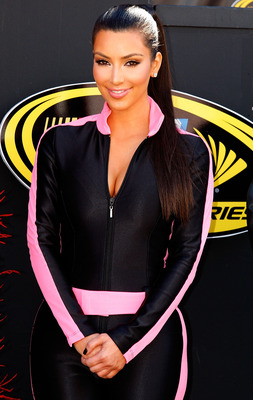 LAS VEGAS - FEBRUARY 28: Television personality Kim Kardashian stands on stage during pre race festivities prior to the start of the NASCAR Sprint Cup Series Shelby American at Las Vegas Motor Speedway on February 28, 2010 in Las Vegas, Nevada.  (Photo by