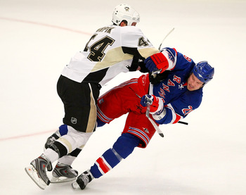 Brooks Orpik drills Colton Orr in an open-ice collision.