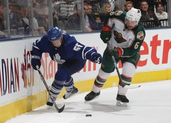 TORONTO, ON - NOVEMBER 10: Greg Zanon #6 of the Minnesota Wild skates against Jason Blake #55 of the Toronto Maple Leafs at the Air Canada Centre on November 10, 2009 in Toronto, Canada.  (Photo by Bruce Bennett/Getty Images)