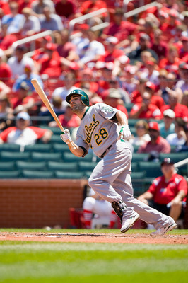 ST. LOUIS - JUNE 20: Conor Jackson #28 of the Oakland Athletics bats against the St. Louis Cardinals at Busch Stadium on June 20, 2010 in St. Louis, Missouri.  (Photo by Dilip Vishwanat/Getty Images)