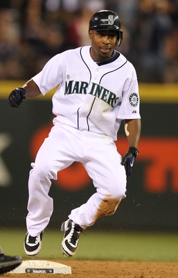 SEATTLE - JULY 24:  Chone Figgins #9 of the Seattle Mariners pulls into second base on an eighth inning double against the Boston Red Sox at Safeco Field on July 24, 2010 in Seattle, Washington. (Photo by Otto Greule Jr/Getty Images)