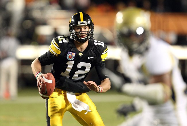 MIAMI GARDENS, FL - JANUARY 05:  Quarterback Richy Stanzi #12 of the Iowa Hawkeyes rolls out of the pocket against the Georgia Tech Yellow Jackets during the FedEx Orange Bowl at Land Shark Stadium on January 5, 2010 in Miami Gardens, Florida. Iowa won 24