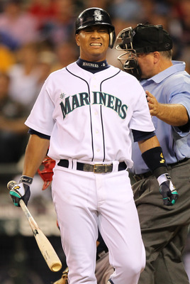 SEATTLE - JULY 24:  Jose Lopez #4 of the Seattle Mariners grimaces after being hit with a pitch against the Boston Red Sox at Safeco Field on July 24, 2010 in Seattle, Washington. (Photo by Otto Greule Jr/Getty Images)