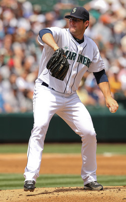 SEATTLE - JULY 11:  Starting pitcher Ryan Rowland-Smith #18 of the Seattle Mariners pitches against the New York Yankees at Safeco Field on July 11, 2010 in Seattle, Washington. (Photo by Otto Greule Jr/Getty Images)