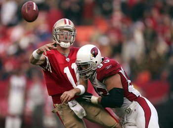 SAN FRANCISCO - DECEMBER 24:  Alex Smith #11 of the San Francisco 49ers is hit by Chris Cooper #93 of the Arizona Cardinals during an NFL game at Monster Park on December 24, 2006 in San Francisco, California.  (Photo by Jed Jacobsohn/Getty Images)
