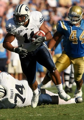 PASADENA, CA - SEPTEMBER 8:  Running back Manase Tonga #11 of the BYU Cougars carries the ball agianst the UCLA Bruins on September 8, 2007 at the Rose Bowl in Pasadena, California. UCLA won 27-17. (Stephen Dunn/Getty Images)