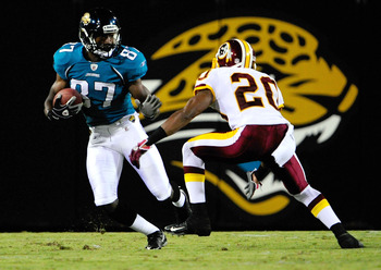 JACKSONVILLE, FL - SEPTEMBER 03:  Jarett Dillard #87 of the Jacksonville Jaguars attempts to run past Justin Tryon #20 of the Washington Redskins during the game at Jacksonville Municipal Stadium on September 3, 2009 in Jacksonville, Florida.  (Photo by S