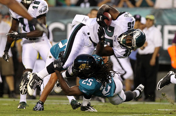 PHILADELPHIA - AUGUST 13: LeSean McCoy #25 of the Philadelphia Eagles is tackled by Reggie Nelson #25 of the Jacksonville Jaguars during their preseason game at Lincoln Financial Field on August 13, 2010 in Philadelphia, Pennsylvania.  (Photo by Nick Laha