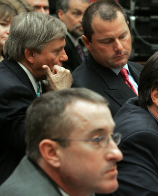 WASHINGTON - FEBRUARY 13:  Major League Baseball player Roger Clemens (R) talks with his attorney Rusty Hardin (L) while Brian McNamee (C), former trainer, sits nearby during a House Oversight and Government Reform Committee hearing February 13, 2008 in W