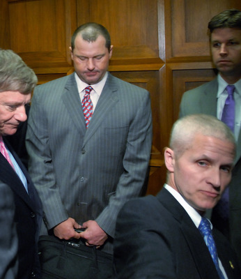 WASHINGTON - FEBRUARY 05:  Former New York Yankees pitcher Roger Clemens (2nd L) departs on an elevator after being deposed by the House Oversight and Government Reform Committee about steroid use in Major League Baseball, February 5, 2008 in Washington.