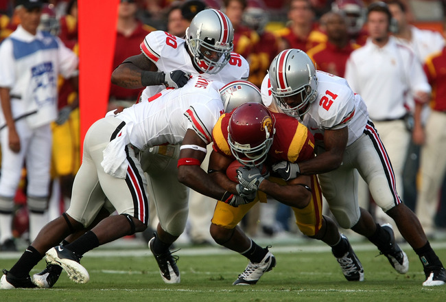 LOS ANGELES, CA - SEPTEMBER 13:  Patrick Turner #1 of the USC Trojans is tackled by three Ohio State Buckeyes defenders during the college football game at the Los Angeles Memorial Coliseum on September 13, 2008 in Los Angeles, California.  (Photo by Step