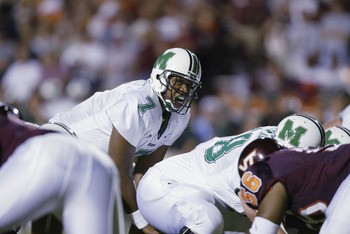 BLACKSBURG, VA - SEPTEMBER 12:  Quarterback Byron Leftwich #7 of the Marshall Thundering Herd calls out the snap count during the NCAA football game against the Virginia Tech Hokies at Lane Stadium on September 12, 2002 in Blacksburg, Virgina.  The Hokies