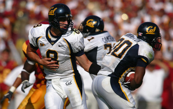 LOS ANGELES - OCTOBER 9:  Aaron Rodgers #8 of the California Golden Bears hands off to running back J.J. Arrington #30 during the game against the USC Trojans on October 9, 2004 at Los Angeles Memorial Coliseum in Los Angeles, California.  The Trojans def